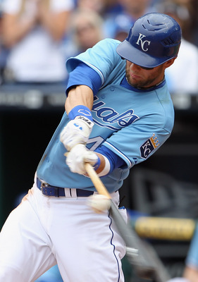 KANSAS CITY, MO - APRIL 17:  Alex Gordon #4 of the Kansas City Royals connects during the game against the Seattle Mariners on April 17, 2011 at Kauffman Stadium in Kansas City, Missouri.  (Photo by Jamie Squire/Getty Images)