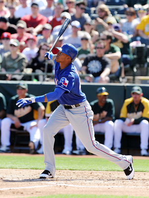 PHOENIX, AZ - MARCH 04:  Engel Beltre #43 of the Texas Rangers follows through on a swing against the Oakland Athletics at Phoenix Municipal Stadium on March 4, 2011 in Phoenix, Arizona.  (Photo by Norm Hall/Getty Images)