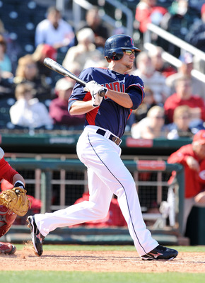 GOODYEAR, AZ - FEBRUARY 27:  Lonnie Chisenhall #76 of the Cleveland Indians follows through on a swing against the Cincinnati Reds at Goodyear Ballpark on February 27, 2011 in Goodyear, Arizona.  (Photo by Norm Hall/Getty Images)