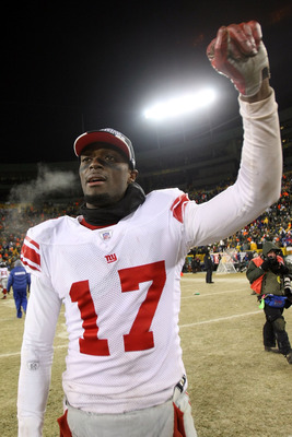 GREEN BAY, WI - JANUARY 20:  Wide receiver Plaxico Burress #17 of the New York Giants celebrates after winning the NFC championship game against the Green Bay Packers on January 20, 2008 at Lambeau Field in Green Bay, Wisconsin.   The Giants defeated the