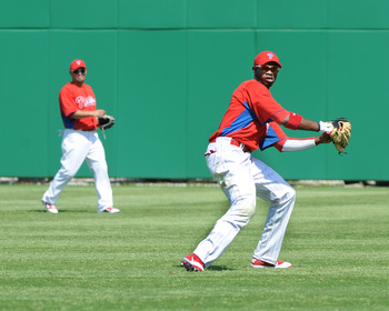 CLEARWATER, FL - FEBRUARY 24:  Outfielder Domonic Brown #9 of the Philadelphia Phillies fields a ball in right field against the Florida State Seminoles February 24, 2011 at Bright House Field in Clearwater, Florida.  (Photo by Al Messerschmidt/Getty Imag