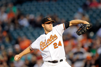 BALTIMORE, MD - APRIL 18:  Chris Tillman #24 of the Baltimore Orioles pitches against the Minnesota Twins at Oriole Park at Camden Yards on April 18, 2011 in Baltimore, Maryland.  (Photo by Greg Fiume/Getty Images)