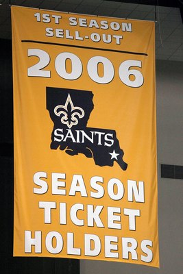 NEW ORLEANS - JANUARY 13:  A banner reading '1st Season Sell-Out 2006 Season Ticket Holders' is unveiled before the NFC divisional playoff game between the Philadelphia Eagles and the New Orleans Saints at the Superdome on January 13, 2007 in New Orleans,