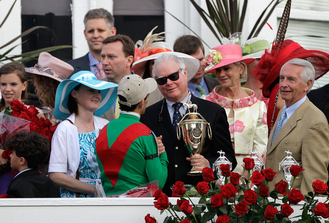 LOUISVILLE, KY - MAY 07:  Barry Irwin, owner of Animal Kingdom congraulates jockey John Velazquez, in the winner's circle after they won the 137th Kentucky Derby at Churchill Downs on May 7, 2011 in Louisville, Kentucky.  (Photo by Rob Carr/Getty Images)