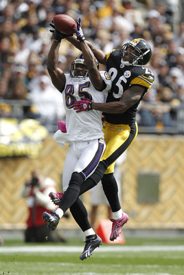 PITTSBURGH - OCTOBER 03: Derrick Mason #85 of the Baltimore Ravens catches a first quarter pass in front of Ryan Clark #25 of the Pittsburgh Steelers on October 3, 2010 at Heinz Field in Pittsburgh, Pennsylvania.  (Photo by Gregory Shamus/Getty Images)