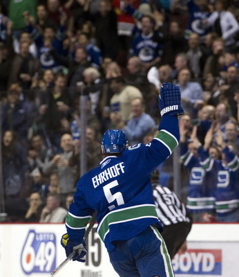 VANCOUVER, CANADA - FEBRUARY 4: Christian Ehrhoff #5 of the Vancouver Canucks celebrates after scoring against the Chicago Blackhawks during the first period in NHL action on February 04, 2011 at Rogers Arena in Vancouver, British Columbia, Canada. (Photo