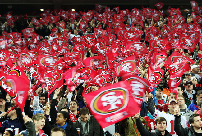 LONDON, ENGLAND - OCTOBER 31:  San Francisco 49ers fans waves flags in support of their team during the NFL International Series match between Denver Broncos and San Francisco 49ers at Wembley Stadium on October 31, 2010 in London, England. This is the fo