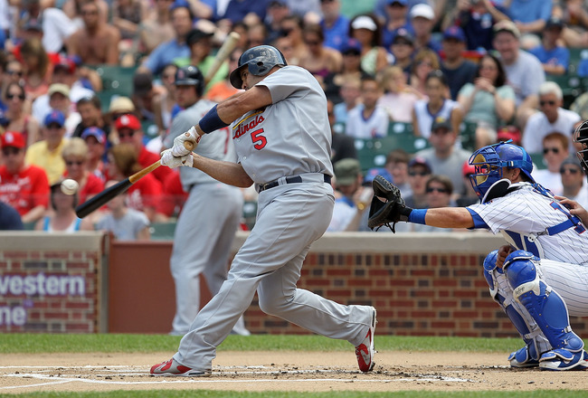 CHICAGO, IL - MAY 30:  Albert Pujols #5 of the St. Louis Cardinals connects on a first inning home run against the Chicago Cubs on May 30, 2010 at Wrigley Field in Chicago, Illinois.  (Photo by Jim McIsaac/Getty Images)