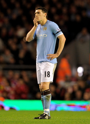 LIVERPOOL, ENGLAND - APRIL 11:  Gareth Barry of Manchester City looks dejected during the Barclays Premier League match between Liverpool and Manchester City at Anfield on April 11, 2011 in Liverpool, England.  (Photo by Michael Regan/Getty Images)