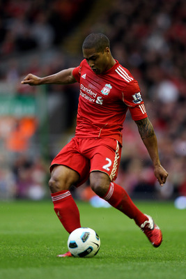 LIVERPOOL, ENGLAND - MAY 15:  Glen Johnson of Liverpool crosses the ball during the Barclays Premier League match between Liverpool and Tottenham Hotspur at Anfield on May 15, 2011 in Liverpool, England.  (Photo by Michael Steele/Getty Images)
