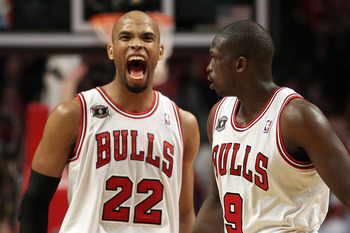 CHICAGO, IL - MAY 15:  (L-R) Taj Gibson #22 and Luol Deng #9 of the Chicago Bulls celebrate a play against the Miami Heat in Game One of the Eastern Conference Finals during the 2011 NBA Playoffs on May 15, 2011 at the United Center in Chicago, Illinois.