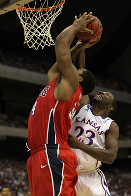 SAN ANTONIO, TX - MARCH 25:  Mario Little #23 of the Kansas Jayhawks blocks the shot by Derrick Williams #34 of the Richmond Spiders of the Richmond Spiders during the southwest regional of the 2011 NCAA men's basketball tournament at the Alamodome on Mar