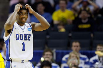 CHARLOTTE, NC - MARCH 20:  Kyrie Irving #1 of the Duke Blue Devils reacts while taking on the Michigan Wolverines during the third round of the 2011 NCAA men's basketball tournament at Time Warner Cable Arena on March 20, 2011 in Charlotte, North Carolina