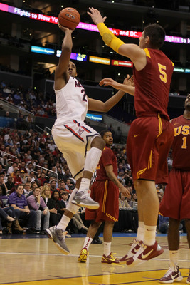 LOS ANGELES, CA - MARCH 11:  Derrick Williams #23 of the Arizona Wildcats shoots the ball over Nikola Vucevic #5 of the USC Trojans in the second half in the semifinals of the 2011 Pacific Life Pac-10 Men's Basketball Tournament at Staples Center on March