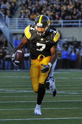 IOWA CITY, IA - OCTOBER 30- Wide receiver Marvin McNutt #7 of the University of Iowa Hawkeyes drives the ball into the end zone for a touch down during the second half of play against the Michigan State Spartans at Kinnick Stadium on October 30, 2010 in I