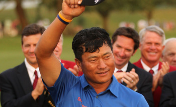 PONTE VEDRA BEACH, FL - MAY 15:  K.J. Choi of South Korea celebrates with the trophy after defeating David Toms on the first playoff hole to win THE PLAYERS Championship held at THE PLAYERS Stadium course at TPC Sawgrass on May 15, 2011 in Ponte Vedra Bea