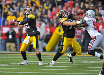 IOWA CITY, IA - NOVEMBER 20:  Quarterback Ricky Stanzi #12 of the University of Iowa Hawkeyes throws under pressure from defensive lineman Solomon Thomas #98 of the Ohio State Buckeyes as offensive lineman Riley Reiff #77 defends during the first half of