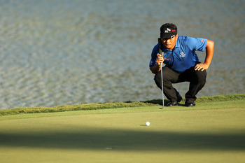 PONTE VEDRA BEACH, FL - MAY 15:  K.J. Choi of South Korea lines up a putt 17th hole during the final round of THE PLAYERS Championship held at THE PLAYERS Stadium course at TPC Sawgrass on May 15, 2011 in Ponte Vedra Beach, Florida.  (Photo by Mike Ehrman