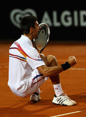 ROME, ITALY - MAY 15:  Novak Djokovic of Serbia celebrates match point during the final against Rafael Nadal of Spain during day eight of the Internazoinali BNL D'Italia at the Foro Italico Tennis Centre on May 15, 2011 in Rome, Italy.  (Photo by Clive Br