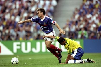12 Jul 1998:  France captain Didier Deschamps is held as he goes past Rivaldo of Brazil during the World Cup Final at the Stade de France in St Denis. France won 3-0.  \ Mandatory Credit: Shaun Botterill /Allsport