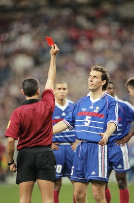 8 Jul 1998:  Referee Jose Garcia-Aranda sends off Laurent Blanc of France for raising a hand at Slaven Bilic of Croatia during the World Cup semi-final at the Stade de France in St Denis. France won 2-1. \ Mandatory Credit: Clive Brunskill /Allsport