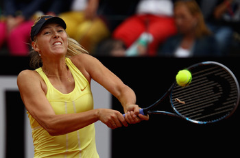 ROME, ITALY - MAY 15:  Maria Sharapova of Russia plays a backhand during the final against Samantha Stosur of Australia during day eight of the Internazoinali BNL D'Italia at the Foro Italico Tennis Centre on May 15, 2011 in Rome, Italy.  (Photo by Clive