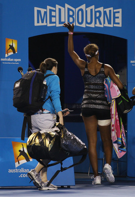 MELBOURNE, AUSTRALIA - JANUARY 21:  Venus Williams of the United States of America acknowledges the crowd as she walks off after retiring hurt in her third round match against Andrea Petkovic of Germany during day five of the 2011 Australian Open at Melbo