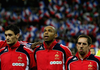 PARIS - NOVEMBER 19:  Thierry Henry (C) of France looks on with team mates during the national anthems ahead of the International Friendly between France and Uruguay at the Stade de France on November 19, 2008 in Paris, France.  (Photo by Hamish Blair/Get