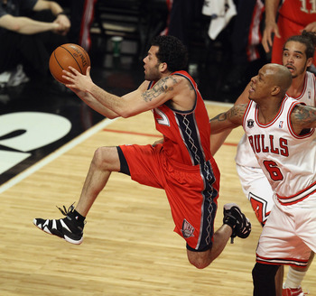 CHICAGO, IL - APRIL 13: Jordan Farmar #2 of the New Jersey Nets drives to the basket past Keith Bogans #6 of the Chicago Bulls at United Center on April 13, 2011 in Chicago, Illinois. NOTE TO USER: User expressly acknowledges and agrees that, by downloadi