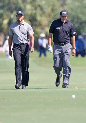 MIAMI, FL - MARCH 11:  Tiger Woods (L) walks up the seventh fairway alongside Phil Mickelson during the second round of the 2011 WGC- Cadillac Championship at the TPC Blue Monster at the Doral Golf Resort and Spa on March 11, 2011 in Doral, Florida.  (Pho