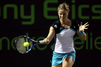 KEY BISCAYNE, FL - MARCH 30:  Kim Clijsters of Belgium hits a forehand return against Victoria Azarenka of Belarus during the Sony Ericsson Open at Crandon Park Tennis Center on March 30, 2011 in Key Biscayne, Florida.  (Photo by Al Bello/Getty Images)