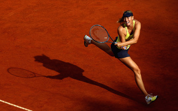 ROME, ITALY - MAY 15:  Maria Sharapova of Russia in action during the final against Samantha Stosur of Australia during day eight of the Internazoinali BNL D'Italia at the Foro Italico Tennis Centre on May 15, 2011 in Rome, Italy.  (Photo by Clive Brunski