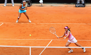 ROME, ITALY - MAY 15:  Shuai Peng and Jie Zheng of China in action during the doubles final against Vania King of the USA and Yaroslava Shvedova of Kazakstan during day eight of the Internazoinali BNL D'Italia at the Foro Italico Tennis Centre on May 15,