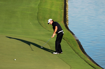 PONTE VEDRA BEACH, FL - MAY 15:  Graeme McDowell of Northern Ireland putts on the 18th hole during the final round of THE PLAYERS Championship held at THE PLAYERS Stadium course at TPC Sawgrass on May 15, 2011 in Ponte Vedra Beach, Florida.  (Photo by Sco