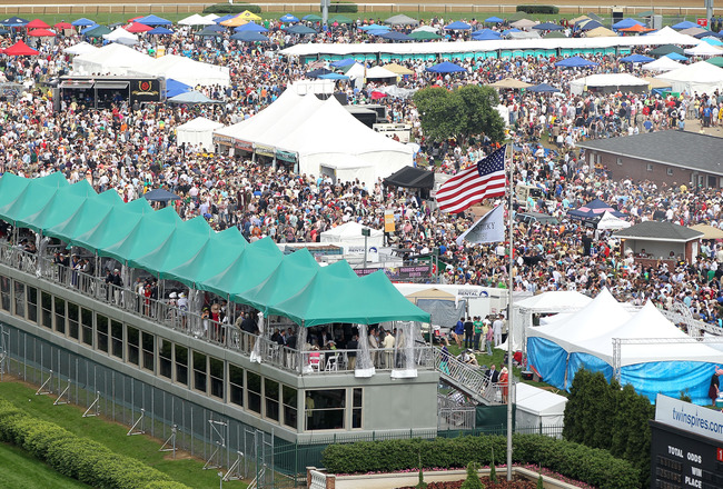 LOUISVILLE, KY - MAY 07:  Fans gather and party in the infield during the 137th Kentucky Derby at Churchill Downs on May 7, 2011 in Louisville, Kentucky.  (Photo by Jamie Squire/Getty Images)