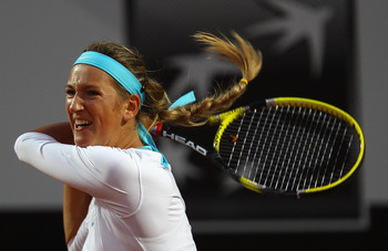 ROME, ITALY - MAY 13:  Victoria Azarenka of Belarus  playsin action during her quarter final match against Maria Sharapova of Russia during day six of the Internazoinali BNL D'Italia at the Foro Italico Tennis Centre  on May 13, 2011 in Rome, Italy.  (Pho