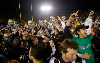 SOUTH BEND, IN - NOVEMBER 13: Players from the Notre Dame Fighting Irish celebrate with fans after a win over the Utah Utes at Notre Dame Stadium on November 13, 2010 in South Bend, Indiana. Notre Dame defeated Utah 28-3. (Photo by Jonathan Daniel/Getty I