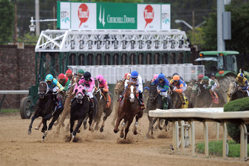 LOUISVILLE, KY - MAY 07:  (L-R) Jockeys Corey Nakatani, riding Nehro #19,  Patrick Valenzuela, riding Comma to the Top #6 and Jesus L. Castanon, riding Shackleford #14, lead the field through turn four during the 137th Kentucky Derby at Churchill Downs on