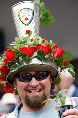 LOUISVILLE, KY - MAY 02:  A race fan with a mint julep in his hand and a hat shaped like one during the 135th running of the Kentucky Derby on May 2, 2009 at Churchill Downs in Louisville, Kentucky.  (Photo by Jamie Squire/Getty Images)