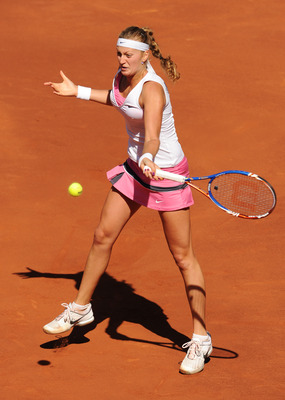MADRID, SPAIN - MAY 08:  Petra Kvitova of the Czech Republic plays a backhand to Victoria Azarenka of Belarus in her final match during day eight of the Mutua Madrilena Madrid Open Tennis on May 8, 2011 in Madrid, Spain.  (Photo by Jasper Juinen/Getty Ima