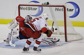 WASHINGTON, DC - MARCH 29:  Tuomo Ruutu #15 of the Carolina Hurricanes scores the game clinching goal on goalie Semyon Varlamov #1 of the Washington Capitals during a shootout at the Verizon Center on March 29, 2011 in Washington, DC. (Photo by Rob Carr/G