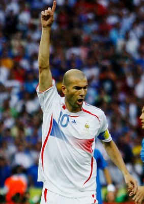 BERLIN - JULY 09:  Zinedine Zidane of France celebrates scoring the opening goal  from the penalty spot during the FIFA World Cup Germany 2006 Final match between Italy and France at the Olympic Stadium on July 9, 2006 in Berlin, Germany.  (Photo by Shaun