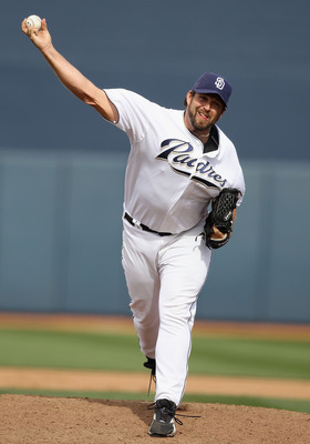 PEORIA, AZ - MARCH 06:  Relief pitcher Heath Bell #21 of the San Diego Padres pitches against the Oakland Athletics during the spring training game at Peoria Stadium on March 6, 2011 in Peoria, Arizona.  (Photo by Christian Petersen/Getty Images)