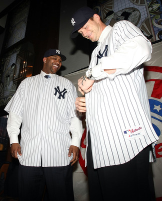 NEW YORK - DECEMBER 18:  (L-R) CC Sabathia and A.J. Burnett put on their new jerseys during a press conference to announce their signing to the New York Yankees at Yankee Stadium on December 18, 2008  in the Bronx borough of New York City.  (Photo by Nick