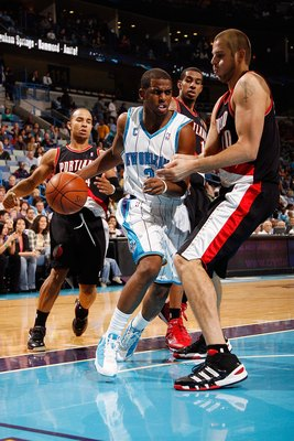 NEW ORLEANS - NOVEMBER 13:  Chris Paul #3 of the New Orleans Hornets drives the ball around Joel Przybilla #10 of the Portland Trail Blazers at the New Orleans Arena on November 13, 2009 in New Orleans, Louisiana.  NOTE TO USER: User expressly acknowledge