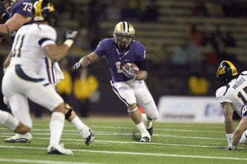 SEATTLE - DECEMBER 05:  Chris Polk #1 of the Washington Huskies carries the ball during game against the California Bears on December 5, 2009 at Husky Stadium in Seattle, Washington. The Huskies defeated the Bears 42-10. (Photo by Otto Greule Jr/Getty Ima