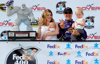 DOVER, DE - MAY 15:  Matt Kenseth (2R), driver of the #17 Wiley X Sunglasses Ford, his wife, Katie(L), and children, Kaylin and Grace Kenseth, pose in Victory Lane during the NASCAR Sprint Cup Series FedEx 400 Benefiting Autism Speaks at Dover Internation
