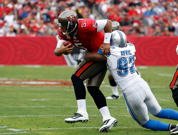 TAMPA, FL - DECEMBER 19:  Defensive end Cliff Avril #92 of the Detroit Lions sacks quarterback Josh Freeman #5 of the Tampa Bay Buccaneers during the game at Raymond James Stadium on December 19, 2010 in Tampa, Florida.  (Photo by J. Meric/Getty Images)