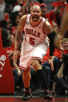 CHICAGO, IL - MAY 15: Carlos Boozer #5 of the Chicago Bulls reacts against the Miami Heat in Game One of the Eastern Conference Finals during the 2011 NBA Playoffs on May 15, 2011 at the United Center in Chicago, Illinois. NOTE TO USER: User expressly ack