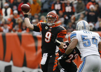CINCINNATI, OH - DECEMBER 6: Carson Palmer #9 of the Cincinnati Bengals throws under pressure from DeAndre Levy #54 of the Detroit Lions in their NFL game at Paul Brown Stadium December 6, 2009 in Cincinnati, Ohio.    (Photo by John Sommers II/Getty Image